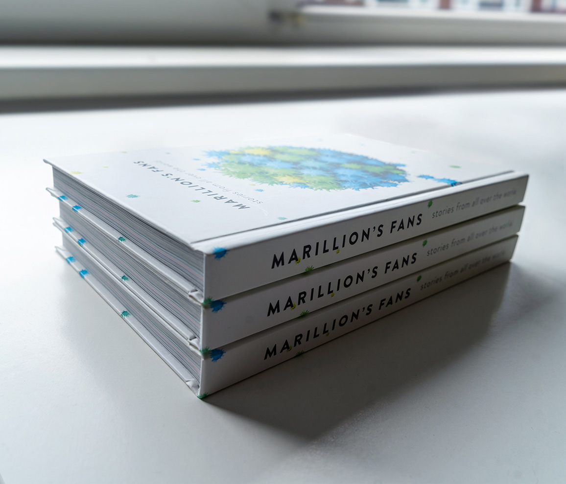 Stack of three marillion's fans books shot from a topview