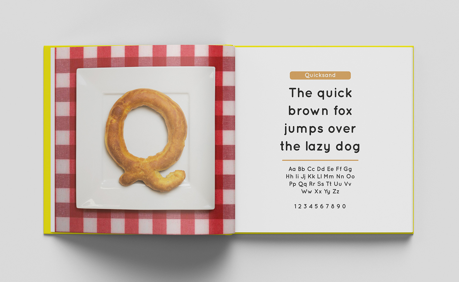 ABC of typography book spread letter Q made from a bagel on a plate